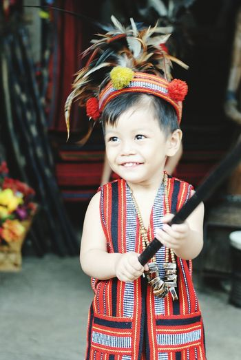 Portrait of boy in traditional clothing