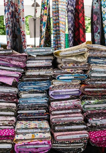 Stack of fabrics for sale in shop