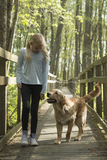 Full length of girl with dog