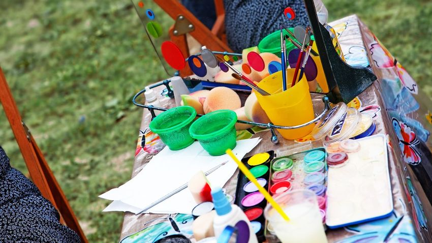 Colors on work table Glasses Open Air Creative Creativity Painting Artwork Drawing Yellow Green Hobbies Relax Tools Table Artistic Painting Art Garden Artist Work Table Painting Mirrow Art And Craft Plastic Glass Brushes Colors Art Multi Colored Day Choice Variation Large Group Of Objects Outdoors