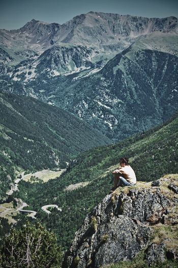Female Hiker Sitting On Mountain