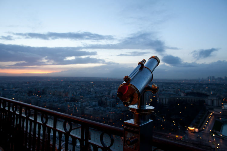 Coin-Operated Binocular At Observation Point By Cityscape Against Sky During Sunset