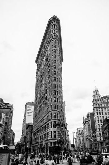 Architecture Building Exterior Built Structure City City Life Crowd Day Flatiron Flatiron Building Flatironbuilding History Large Group Of People Low Angle View Men Modern Outdoors People Real People Sky Skyscraper Tall - High Tourism Tower Travel Destinations Women