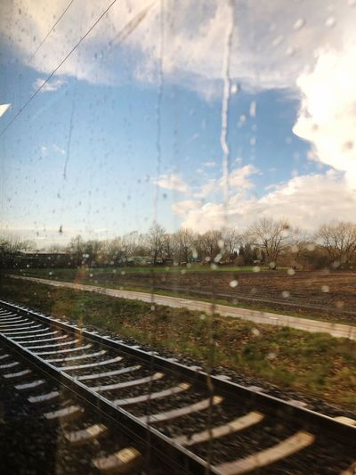 Sky Nature Cloud - Sky No People Glass - Material Window Transparent Transportation Rail Transportation Railroad Track Track Wet Outdoors Drop Rain Mode Of Transportation Vehicle Interior