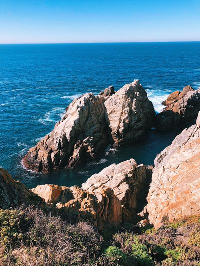 Sea Horizon Over Water Rock - Object Water Nature Tranquil Scene Scenics Rock Formation Rocky Coastline Beach No People Outdoors Idyllic Tranquility Beauty In Nature Cliff Day Blue Clear Sky Sky