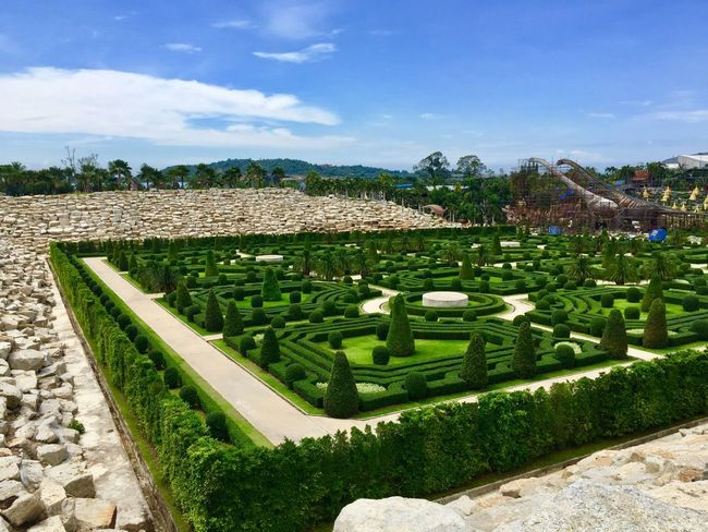 Agriculture Beauty In Nature Cloud - Sky Day Field Flowerbed Formal Garden Garden Garden Path Grass Green Color Growth Hedge Land Landscape Nature No People Ornamental Garden Outdoors Plant Sky Sunlight Tranquil Scene Tree
