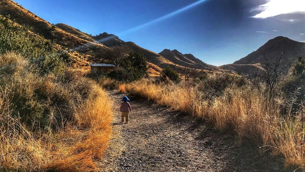 Childhood Child One Person Full Length Sunlight Day Nature Lifestyles Real People Leisure Activity Mountain Sky Grass Beauty In Nature Landscape Outdoors People