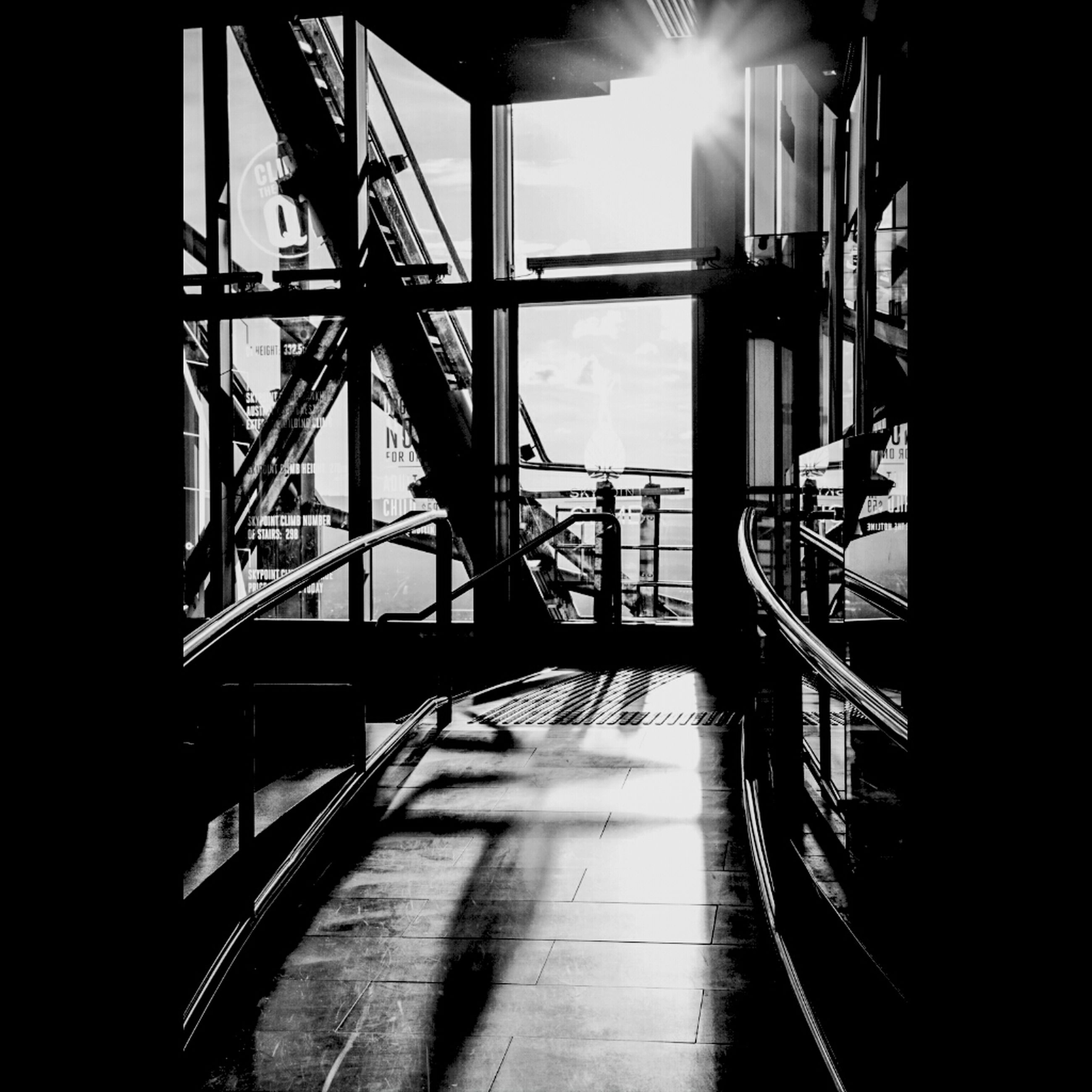 indoors, railing, sunlight, built structure, transportation, architecture, the way forward, shadow, empty, silhouette, absence, metal, no people, connection, steps, clear sky, staircase, day, sunbeam, steps and staircases