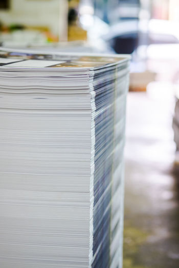 Close-up of stacked newspapers