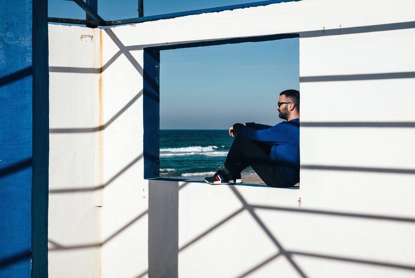 Composition Natural Light Shadows & Lights FujiX100T One Person Real People Sea Lifestyles Built Structure Young Men Outdoors VSCO Cam Freedom Beach Architecture One Man Only Minimalism Atmosphere The Portraitist - 2017 EyeEm Awards Breathing Space