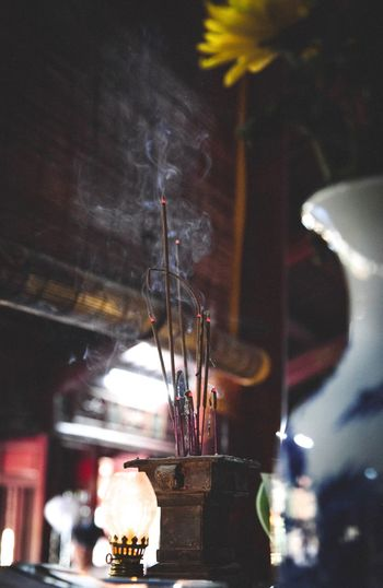Hoi An Temple Incense Sticks Jossstick Offertory Table Indoors  Illuminated No People Lighting Equipment Focus On Foreground Arts Culture And Entertainment Low Angle View