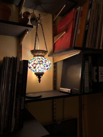 Low angle view of illuminated pendant lights hanging at home