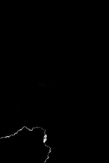Close-up of water splashing against black background