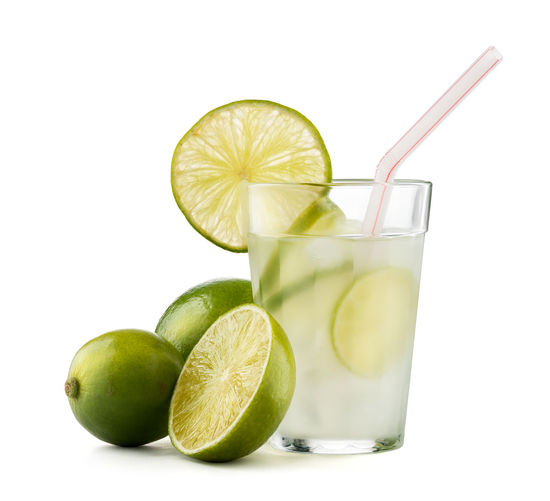 Caipirinha - brazilian's national cocktail made with cachaca, sugar and lemon or lime, isolated on white background with clipping path Brazil Alcoholic Drink Brazilian Caipirinha Caipiroska Citrus Fruit Close-up Drink Drinking Glass Drinking Straw Food And Drink Freshness Fruit Lemon Lime No People Refreshment SLICE Studio Shot White Background