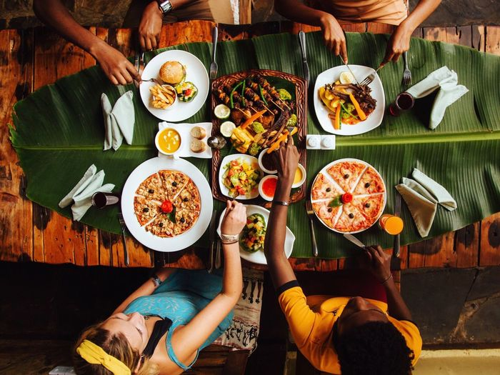 The last supper Food And Drink Food Healthy Eating Human Hand Table Freshness Plate Wellbeing Hand Human Body Part Meal Ready-to-eat High Angle View Lifestyles Real People Sitting People Adult Vegetable