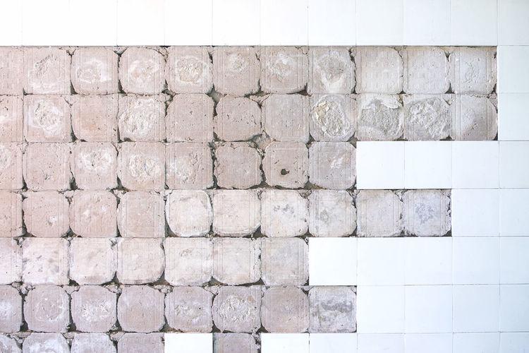 Full Frame Shot Of Incomplete Tiled Wall