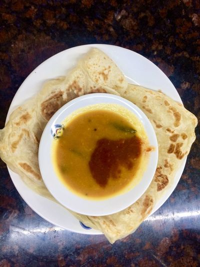 eating 'roti canai' at mamak restaurant Tradition Culture Malaysian Food And Drink Food And Drink Freshness Table Plate Healthy Eating Indoors  Food High Angle View Directly Above Serving Size Ready-to-eat Day Close-up