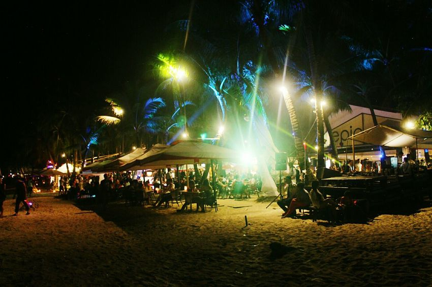 Beach Travel Alone Journey Adventure Large Group Of People Arts Culture And Entertainment Illuminated Night Real People Leisure Activity Outdoors Lifestyles Crowd Nightlife People Nature