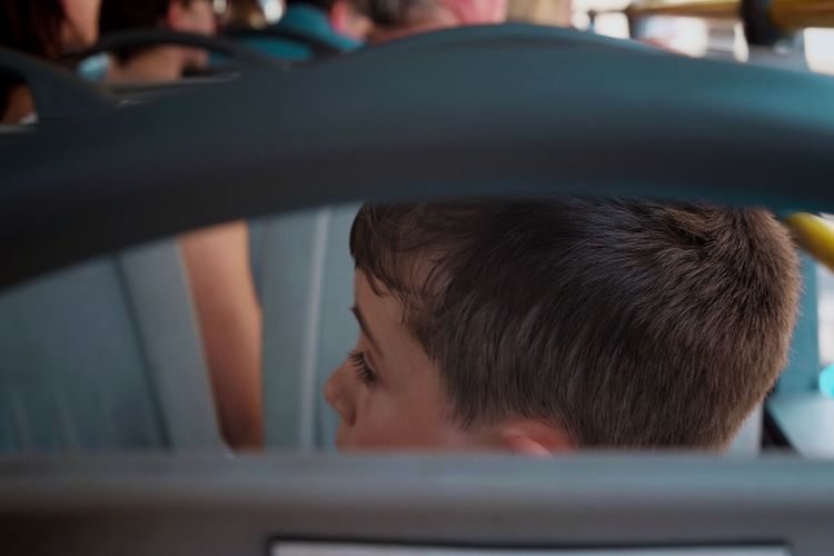 Close-up portrait of boy in car