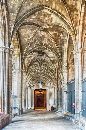 BARCELONA - AUGUST 8: Interior of the gothic Cathedral of the Holy Cross and Saint Eulalia, aka Barcelona Cathedral, Catalonia, Spain, on August 8, 2017 Architecture Arch Building Place Of Worship History Built Structure The Past Religion Belief No People Day Indoors  Spirituality Arcade Architectural Column Ceiling Direction The Way Forward Gothic Style Abbey