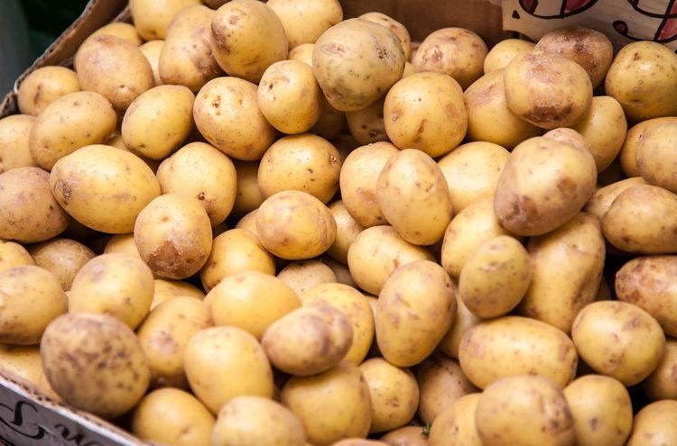 Potatoes at market stall Food Freshness Green Market Harvest Time Market Market Stall Organic Food Potato Crop Potatoes Vegetables