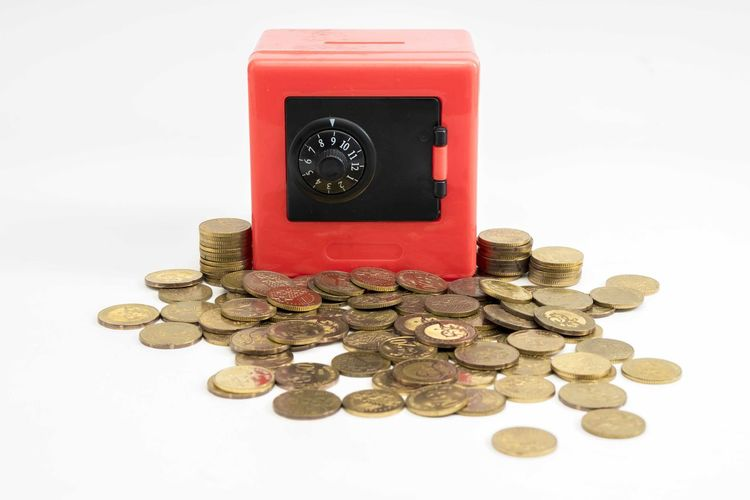 Red safe box and coins White Background Coin Finance Studio Shot Wealth Currency Business Still Life Indoors  Savings No People Large Group Of Objects Cut Out Abundance Investment Close-up Stack Shiny Number Metal Economy