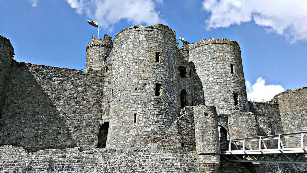 Harlech Harlech Castle Landmark Historical Architecture Historical Building Wales Sandstone Stonewalls Stone Castle Bridge Flag Welsh Flag Blue Sky Clouds