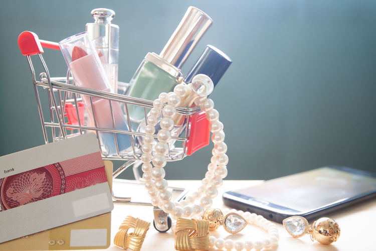 Close-up of personal accessories on table