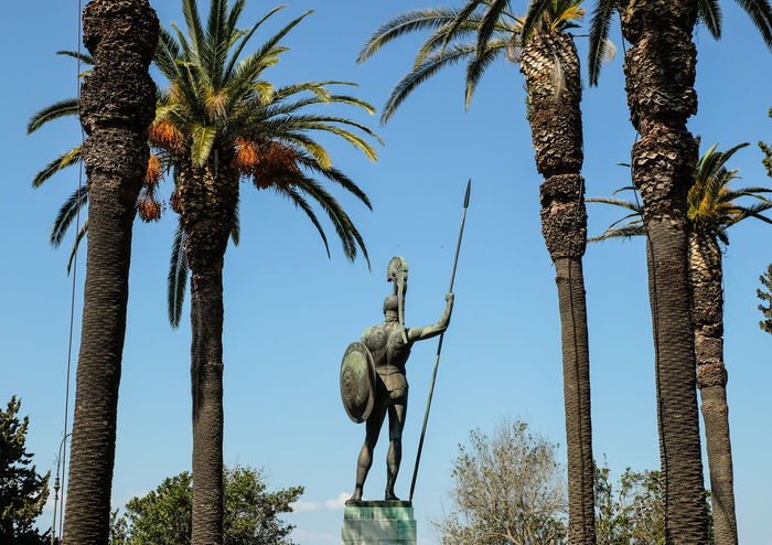 Achilles Art And Craft Clear Sky Day Greece Greek Human Representation Low Angle View Male Likeness Nature No People Outdoors Palm Tree Sculpture Sky Statue Tree Tree Trunk