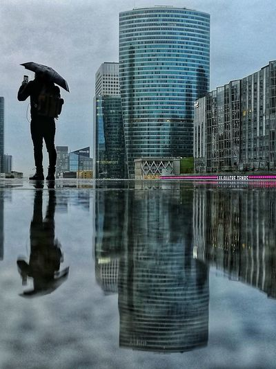 Photographe sous la pluie. Mobilephotography Smartphonephotography #architecture #building #TagsForLikes #architexture #city #buildings #skyscraper #urban #design #minimal #cities #town #street #art #arts #architecturelovers #abstract #lines #instagood #beautiful #archilovers #architectureporn #lookingup #style #archidai #citylife City Cityscape Water Urban Skyline Men Skyscraper Politics And Government Standing Modern Rainy Season Umbrella Puddle