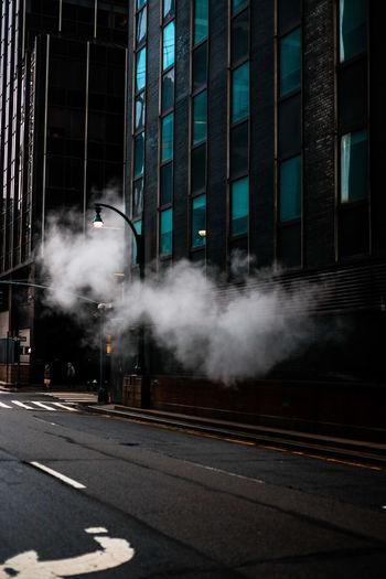 Smoke emitting from car on street