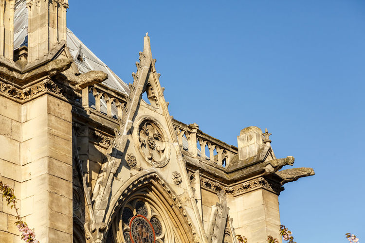 Notre-Dame Notre Dame Cathedral Architecture Built Structure Building Exterior Low Angle View Sky The Past Building History Religion Belief Place Of Worship Spirituality Day Travel Destinations Nature Blue Sculpture Art And Craft No People Outdoors Ornate
