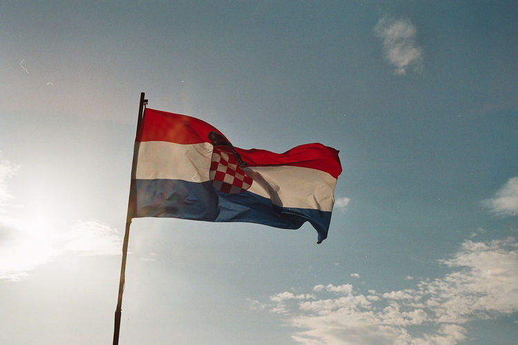 Low Angle View Of Croatian Flag Against Sky