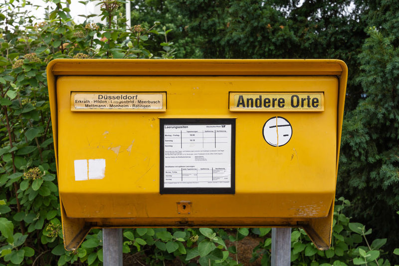 Close-up Communication Correspondence Day Letter Mail Mailbox Message Metal Nature No People Non-western Script Outdoors Plant Public Mailbox Script Sign Text Tree Western Script Yellow