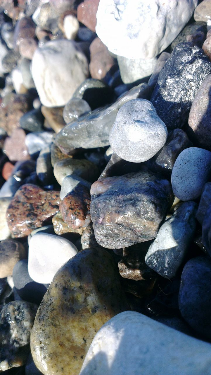 pebble, stone - object, rock - object, full frame, nature, pebble beach, shiny, outdoors, no people, beauty in nature, backgrounds, close-up, day