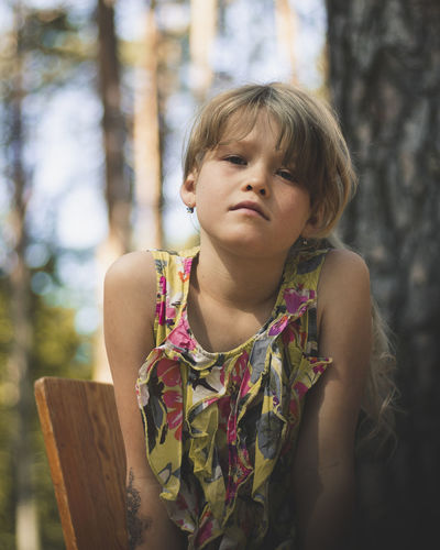Portrait of girl against tree