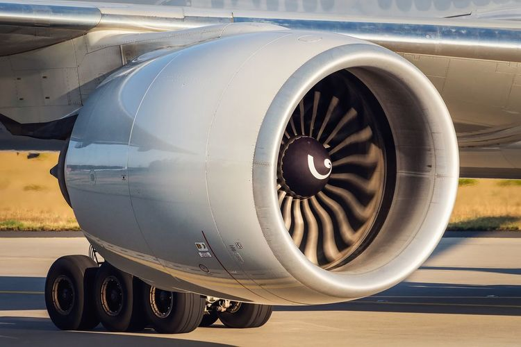 EyeEm Selects Airplane Transportation Air Vehicle Jet Engine Commercial Airplane Aerospace Industry Engine Mode Of Transport Airport Technology Vehicle Part No People Close-up Outdoors Day Boeing 777 Ge90