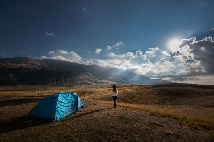 Scenic view of tent on field against sky