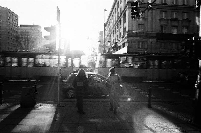 Rollei 400 RPX; Analog in Warsaw The Week on EyeEm Film Photography Analogue Photography Black And White Bnw Monochrome Light And Shadow Capture The Moment Nikonphotography Architecture Built Structure Building Exterior City Real People Street City Life Full Length Walking Building Group Of People Lifestyles Day Nature Men People Footpath Motion Rear View Transportation Outdoors Rain