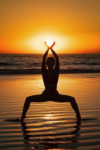 Sunset vibes Sunset Relaxation Exercise Sky Yoga Exercising Water Sea Leisure Activity Lifestyles Horizon Over Water Meditating Spirituality Tranquil Scene Beach Tranquility Sport Wellbeing Healthy Lifestyle Orange Color Relaxation