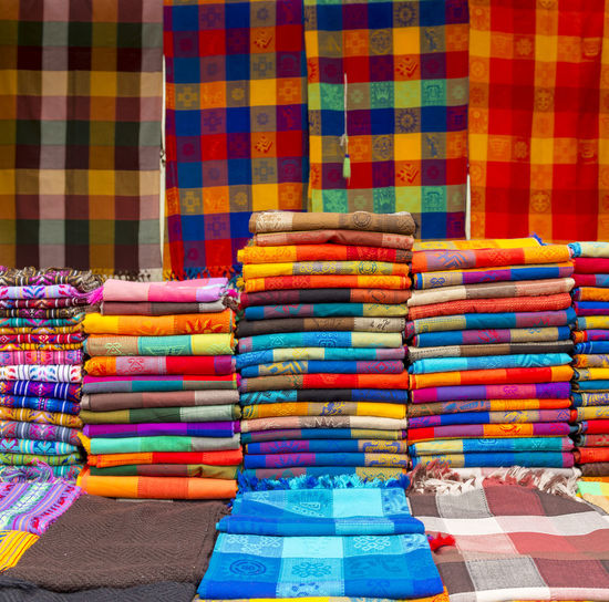 Stack of multi colored textile for sale at market stall