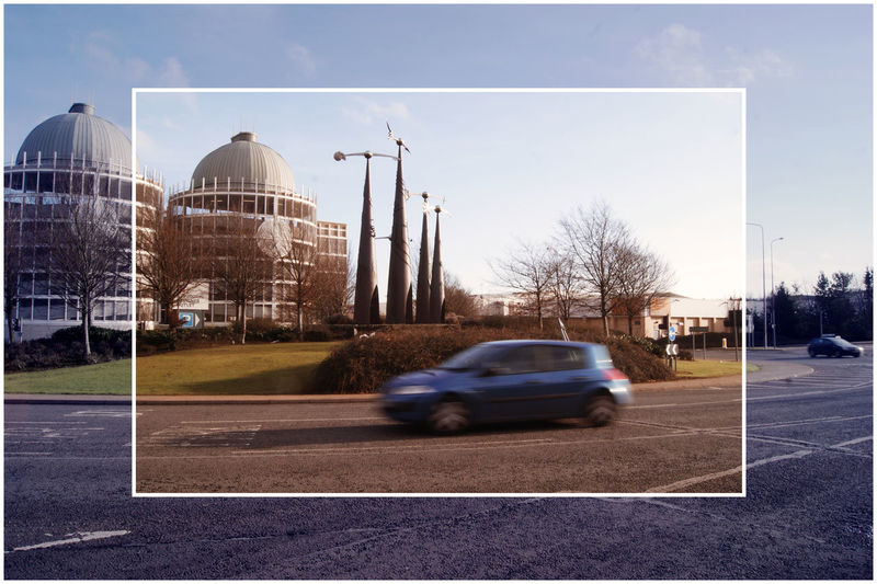 Two pictures into one. Everything static except car Architecture Car On A Roundabout City Day Moving Car No People Outdoors Roundabout Traffic