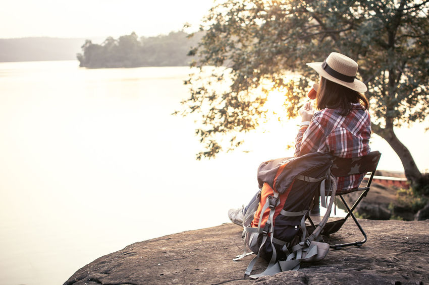 Hat Lifestyles Looking At View Nature One Person Outdoors Real People Relaxation Sitting Tree Water