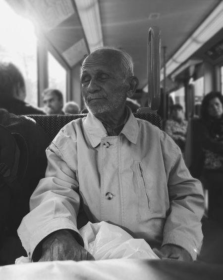 Rear view of man sitting on corridor