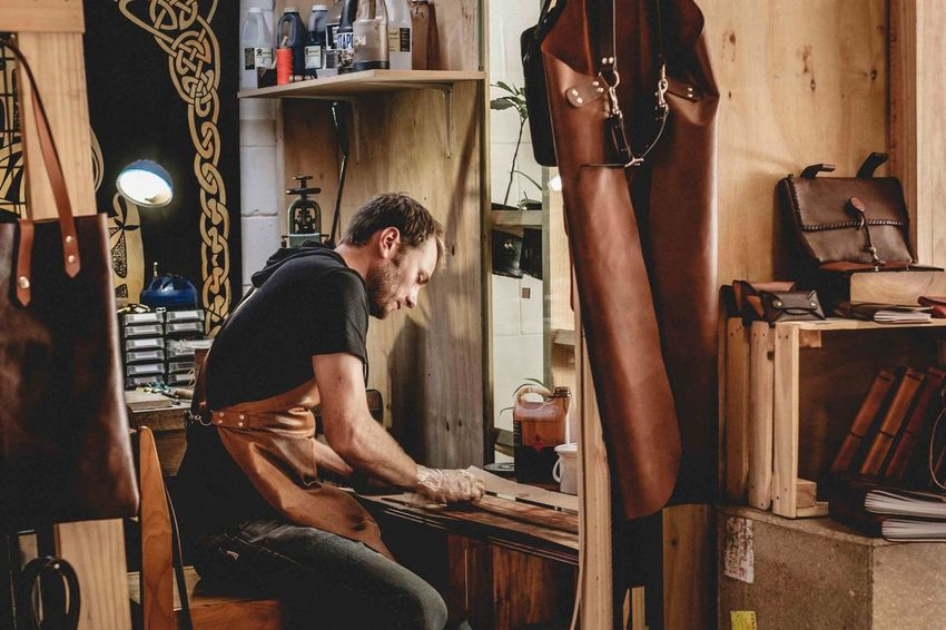 Leather Craft Small Business Heroes One Person Indoors  Young Adult Adult Side View Real People Working Mid Adult Industry Entrepreneur Lifestyles
