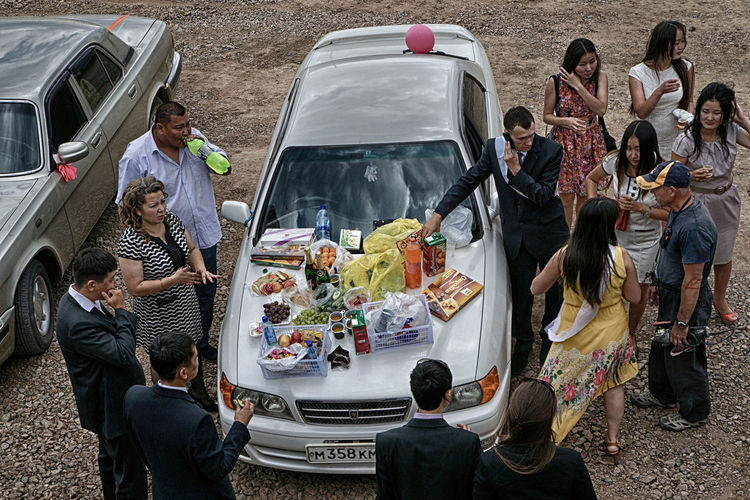 Group Of People Men Transportation Women Real People Mode Of Transportation Adult High Angle View Car Males  Togetherness Motor Vehicle Crowd Large Group Of People Food Food And Drink Sitting Day Standing Mature Men Outdoors