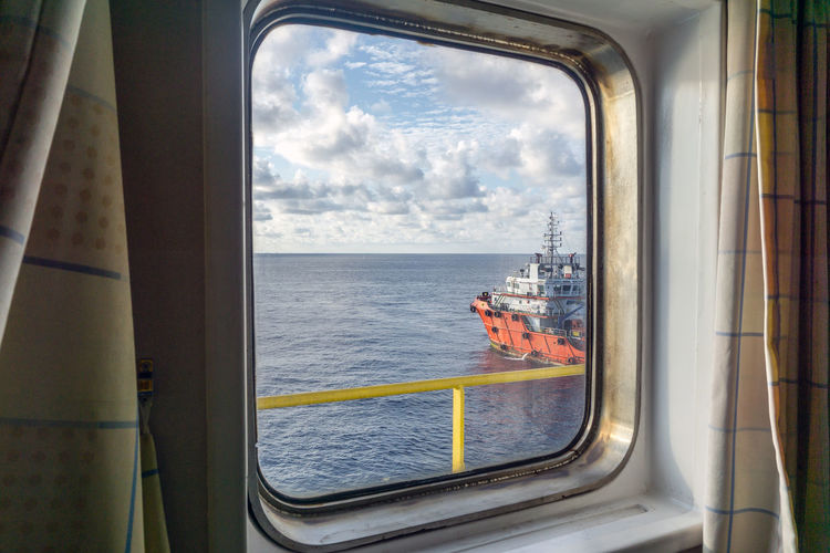take a peek Horizon Upstream Petroleum Peek Outside Frame Oil And Gas Industry Oil Field Ocean Sea Offshore Offshore Life Ship Vessel Tug Boat Cloudy Day Wave Water Window Sky Cloud - Sky Boat Water Vehicle Nautical Vessel