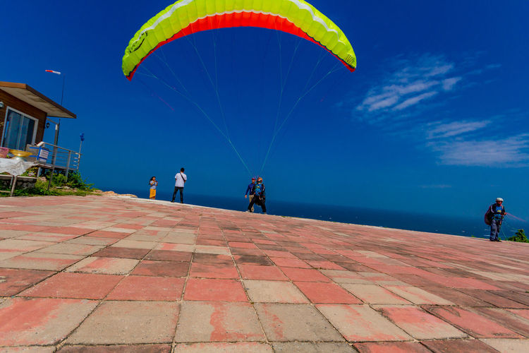 Tourists travel parachute man and sea view at koh lan beach, Pattaya thailand Sky Real People Sea Leisure Activity Group Of People Water Men Lifestyles Sport Women Day Blue Nature People Horizon Over Water Horizon Parachute Outdoors