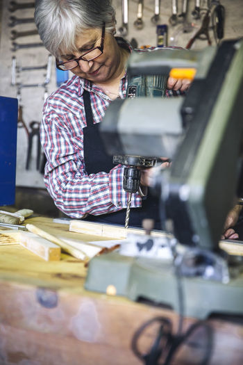 Senior woman working in factory