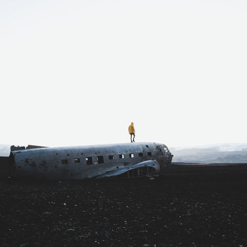 Walking on a giant. Paint The Town Yellow Crash Destruction Iceland The Week On EyeEm Abandoned Airplane Beach Black Sand Beach Clear Sky Damaged Military Airplane Nature Night Outdoors Sunrise Travel Yellow Lost In The Landscape